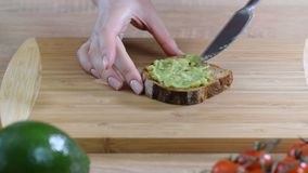 Making avocado toast with bread.  stock video