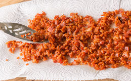 Making bacon bits for salads Stock Images