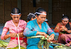 MAKING BALINESE OFFERINGS Stock Photography