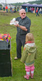 Making balloon figures at Grantown Show. Royalty Free Stock Photo