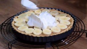 Making banana cream tart with whipped cream. HD stock video footage