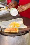 Making banana pancakes Royalty Free Stock Image