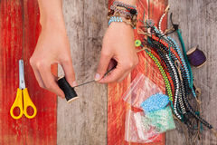 Making bead bracelets Royalty Free Stock Photos