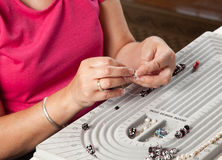 Making bead necklace Royalty Free Stock Photography
