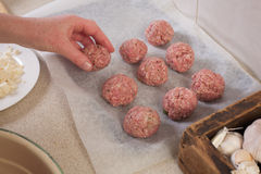 Making beef meatballs. Making home made beef and onion meat balls royalty free stock image