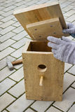 Making a birdhouse from boards spring season Stock Photo