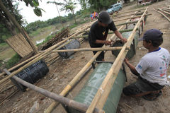 Making boat from bamboo and drums. Workers completed the manufacturing of boats made of bamboo and drums in Solo, Central Java, Indonesia. Handmade boats were Royalty Free Stock Photography