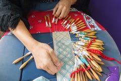 Making bobbin lace Royalty Free Stock Photo