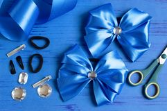 Making bow for girl`s hairstyle royalty free stock image