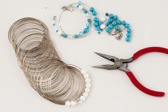 Making a bracelet of turquoise. beads, wire tools Royalty Free Stock Photography