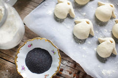 Making bread penguins with poppy seeds, handmade wheat buns Stock Photo