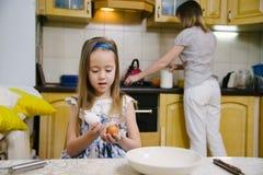 Making breakfest. Little mother's helper Royalty Free Stock Image