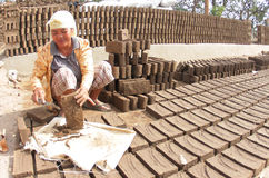 Making bricks from clay Stock Images
