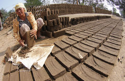 Making bricks from clay Stock Image