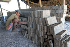 Making bricks. Craftsmen making bricks in a dry plantation area in Boyolali, Central Java, Indonesia royalty free stock photography