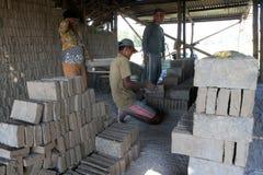 Making bricks. Craftsmen making bricks in a dry plantation area in Boyolali, Central Java, Indonesia royalty free stock photos