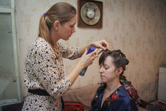 Making bride`s  makeup and coiffure Stock Photography