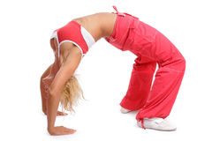 Making a bridge. Athletic tanned girl in red sportive gear making a bridge Stock Photo