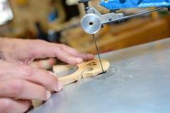 Making bridge for violin Royalty Free Stock Images