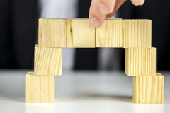 Making a bridge of wooden cubes Stock Photography