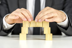 Making a bridge with wooden cubes Royalty Free Stock Images