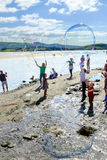 Making bubbles on the beach, Portmeirion Stock Photo