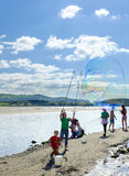 Making bubbles on the beach, Portmeirion Royalty Free Stock Photo