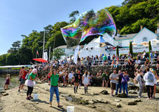 Making bubbles on the beach, Portmeirion Royalty Free Stock Photos