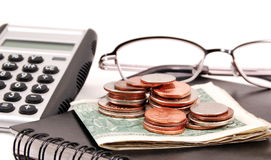 Making a Budget. Planner, calculator and black glasses on a white background with money Stock Photos