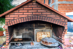 Making burgers in big barbecue grill fireplace with different ac Royalty Free Stock Images