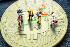Making business counting on crypto currencies especially bitcoin. Closeup of golden bitcoin coin with a chart reflection on its surface with green and red bars Stock Image