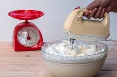 Making butter  cream cake. Using hand mixer Stock Image