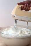 Making butter cream cake. Using hand mixer stock images