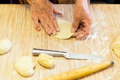 Making cabbage pies of dough Royalty Free Stock Photography
