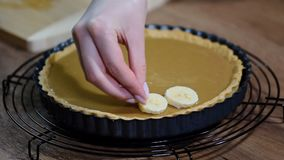 Making cake Banoffi with caramel and banana. HD stock video