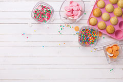 Making cake pops on white wooden background. Confetti  sprinkles. Selective focus.Place for text Stock Photo