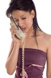 Making a call. Young business brunette woman making a call phone royalty free stock photography