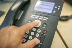 Making a call in a black telephone.  Stock Photography