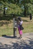 Making a call at a pay phone Royalty Free Stock Image