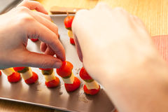 Making Canapes. Cheese Cherry Tomatoes Stock Images