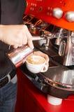 Making cappuccino. Coffee house. The barman prepares for cappuccino Stock Photo