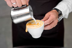 Making cappuccino with art shape Royalty Free Stock Image