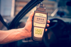 Making car diagnostics using obd device. OBD is On Board Diagnostics, an electronics self diagnostic system, typically used in automotive applications royalty free stock photography