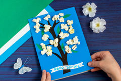 Making card by a child on spring theme. Step 8. Making card by a child on spring theme. Blossoming tree on a blue background. Original children`s art project royalty free stock photography