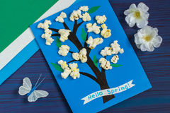 Making card by a child on spring theme. Step 8. Making card by a child on spring theme. Blossoming tree on a blue background. Original children`s art project stock image