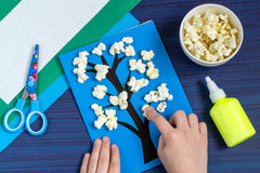 Making card by a child on spring theme. Step 5. Making card by a child on spring theme. Blossoming tree on a blue background. Original children`s art project royalty free stock photos