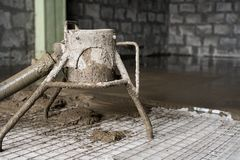 Making cement screed on the floor view Stock Photos