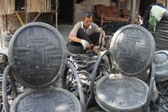 Making chair from waste tire Stock Photo