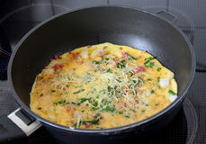 Making a cheese omelette Royalty Free Stock Photo