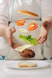 Making cheeseburger at home Royalty Free Stock Photo